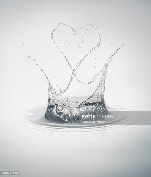 Clean water splash with heart shape