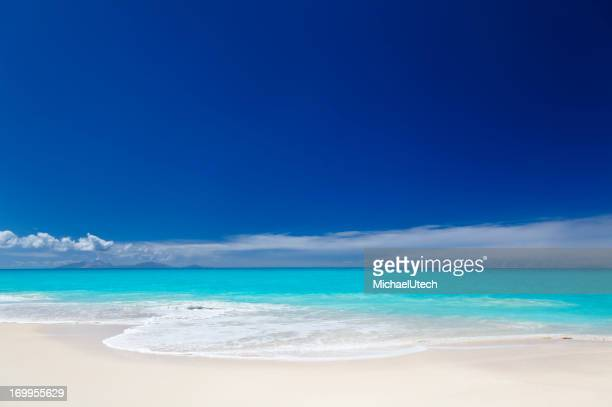 Clean White Caribbean Beach With Blue Sky