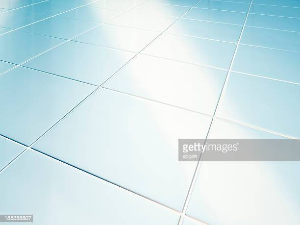 Clean white tiled floor in bathroom