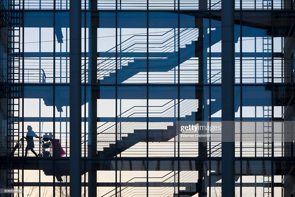Cleaner in a stairwell of an office building, Stuttgart, Baden-Wuerttemberg, Germany, Europe : Stock Photo