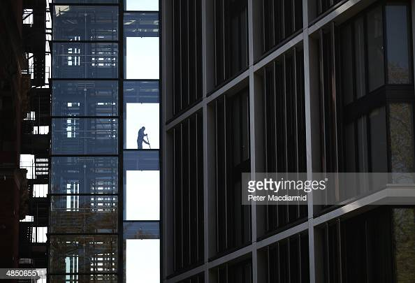 A cleaner mops the floor at the new luxury penthouse development One Hyde Park in Knightsbridge on April 16 2014 in London England The capital...