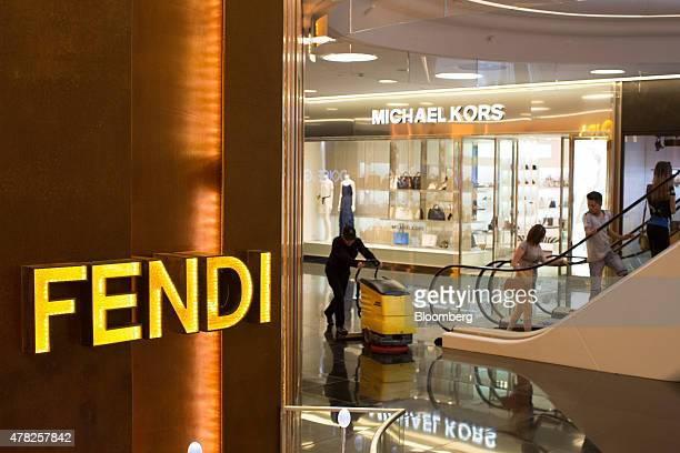 A cleaner polishes the floor between Fendi SpA and Michael Kors Holdings Ltd fashion stores at the Esentai luxury shopping mall in Almaty Kazakhstan...