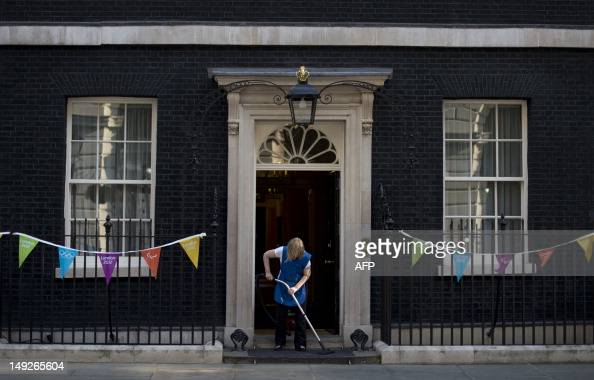 A cleaner vacuums the doorstep of 10 Downing street in central London on July 26 with one day to go before the start of the London 2012 Olympic Games...