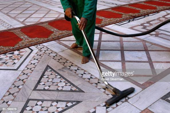 A cleaner vacuums the marble floors of the Mamluk 14th century madrasa and mausoleum of Sultan Hasan February 23 2009 in Cairo Egypt Despite being...