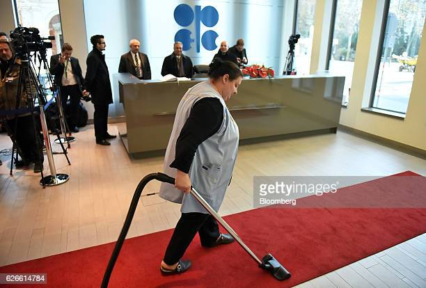 A cleaner vacuums the red carpet ahead of attendees arriving for the 171st Organization of Petroleum Exporting Countries meeting in Vienna Austria on...