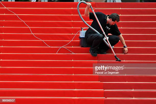 A cleaner vacuums the red carpet during the 63rd Annual Cannes Film Festival on May 16 2010 in Cannes France