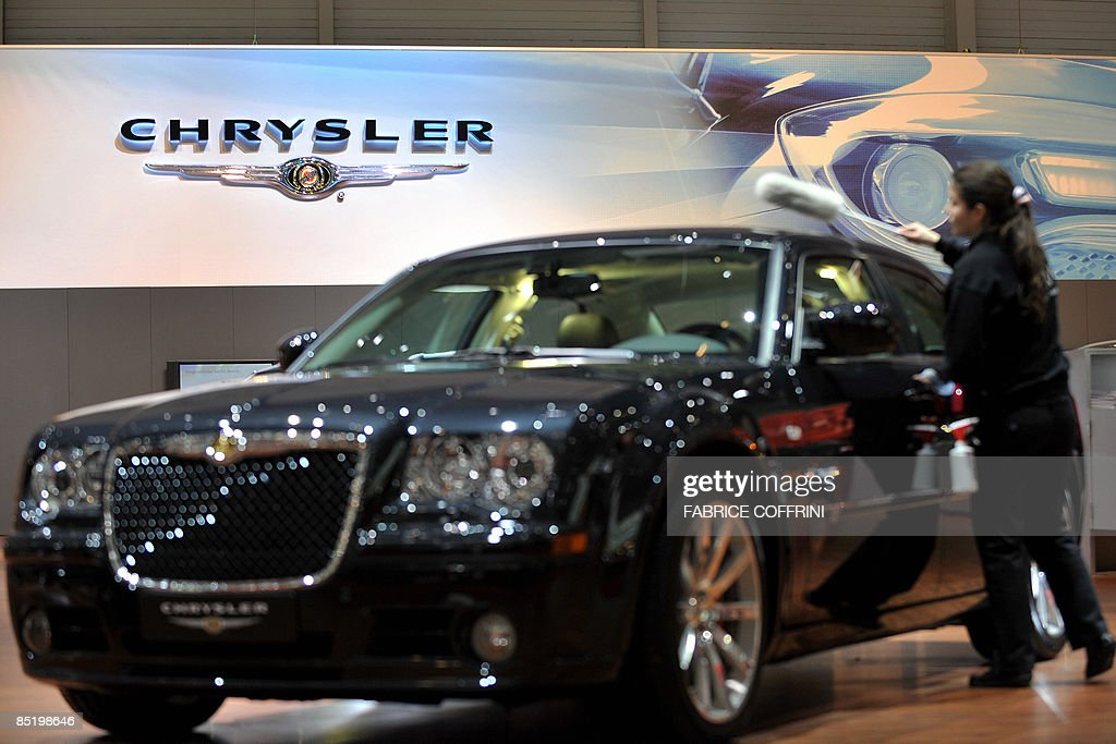 A cleaner wipes a car at the Chrysler booth during the first media day of the 79th Geneva Car Show on March 3, 2009 in Geneva. Crisis-hit automobile giants heralded a bruising battle for cash-strapped buyers at the Geneva Motor Show on Tuesday, as they struggle to make the best of a fast shrinking market by unveiling new 'green' models. Chrysler Vice Chairman Jim Press reiterated in Geneva that his company had not ruled out Chapter 11 bankruptcy protection unless it receives a US government bailout.