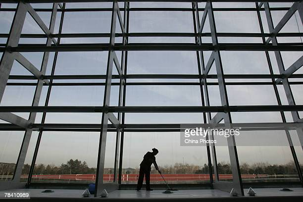 A cleaner works in the National Grand Theater on December 12 2007 in Beijing China The National Grand Theater staged its trial performances on...