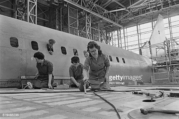 Cleaners at work on the prototype supersonic airliner Concorde 002 at the British Aircraft Corporation works at Filton Bristol 30th January 1967