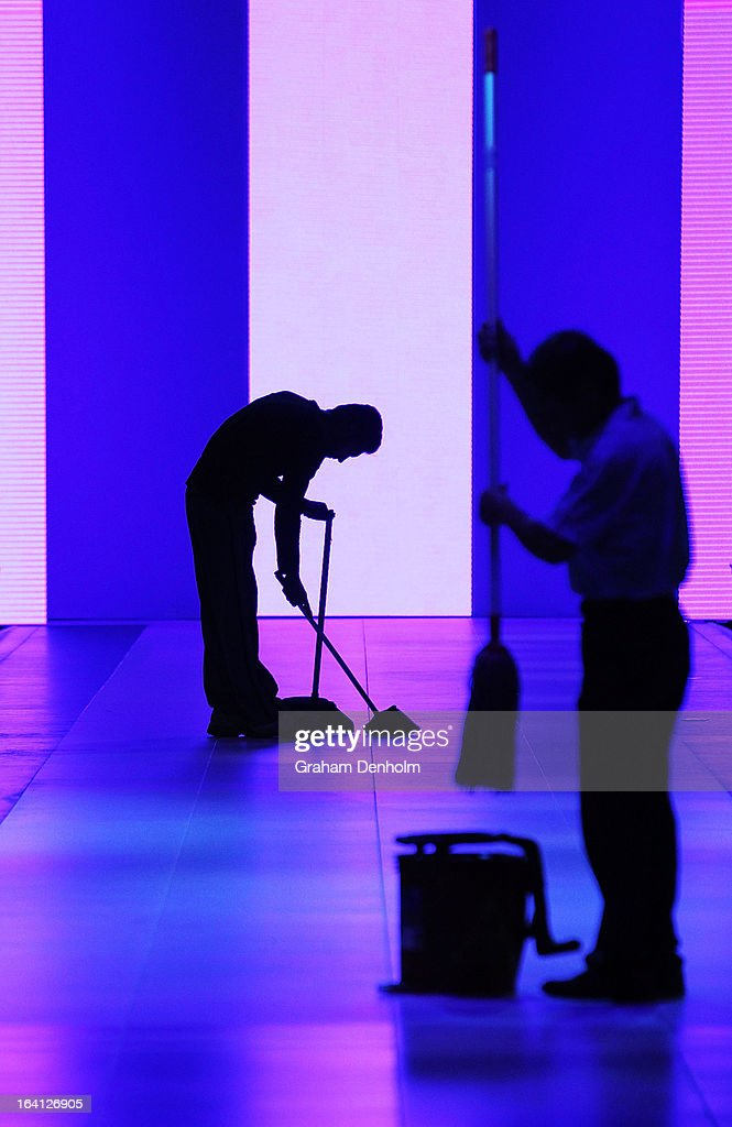Cleaners attend to the runway during L'Oreal Melbourne Fashion Festival on March 20, 2013 in Melbourne, Australia.
