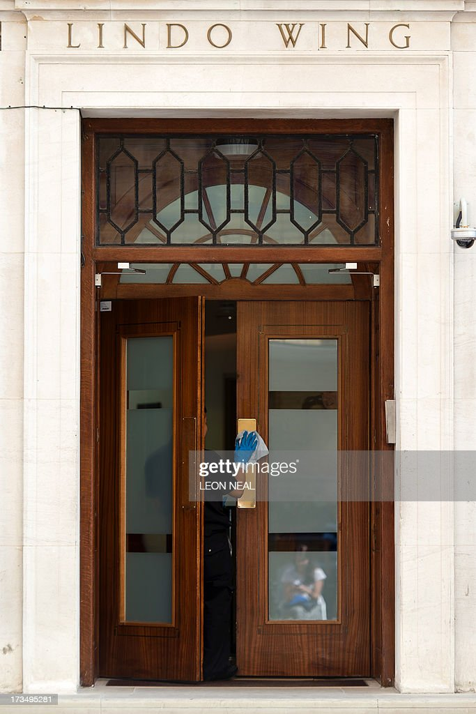 A cleaner's hand reaches out to clean the door of the Lindo Wing of Saint Mary's Hospital in London, on July 15, 2013, where Prince William and his wife Catherine's baby will be born. The hospital is ready, the Wikipedia page and Twitter accounts are up and Britain's famously creative press are running out of ideas. But Sunday arrived with no sign of the royal baby.