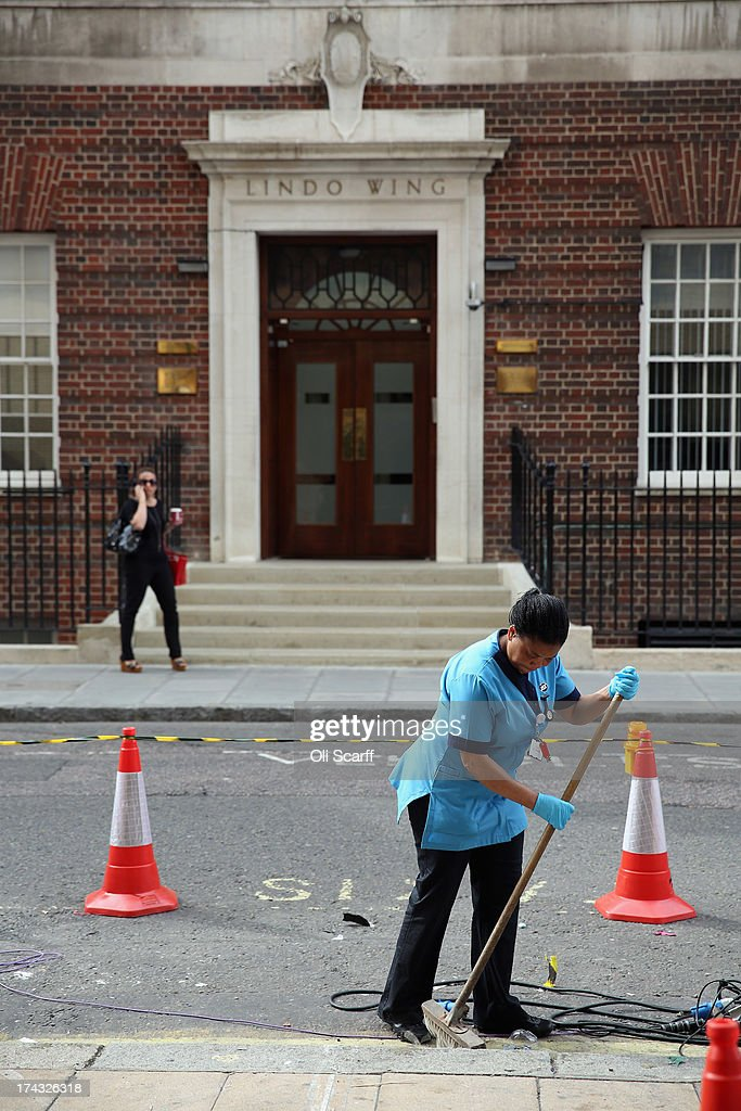 Cleaners sweep the pavement outside St Mary's Hospital the morning after the departure of Prince William, Duke of Cambridge and Catherine, Duchess of Cambridge with their newborn son on July 24, 2013 in London, England. The Duchess of Cambridge gave birth to a boy at 16.24 BST on July 22, 2013 weighing 8lb 6oz, with Prince William at her side. The baby, as yet unnamed, is third in line to the throne and becomes the Prince of Cambridge.
