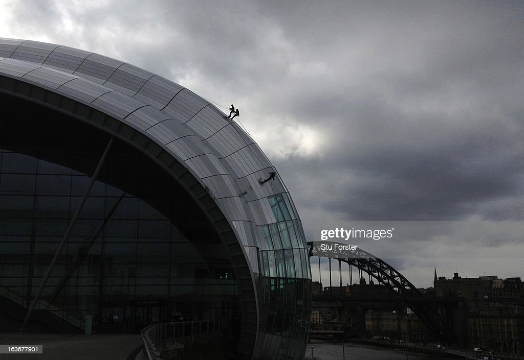 Cleaners work on the windows of the Sage Gateshead centre on March 14, 2013 Newcastle upon Tyne, England.