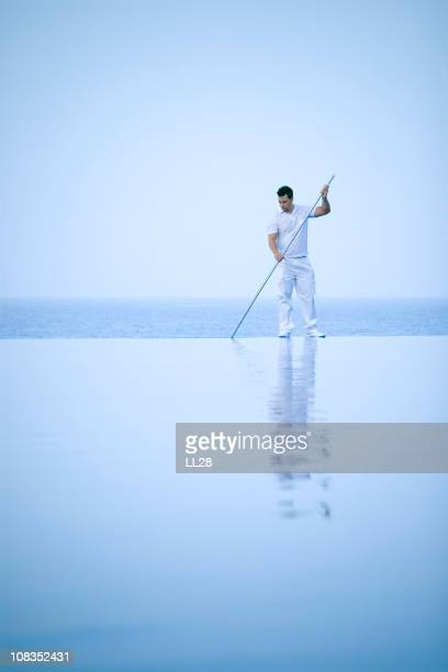 Cleaning a pool at dawn
