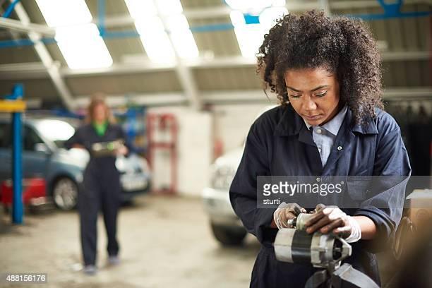 Cleaning an alternator in a garage