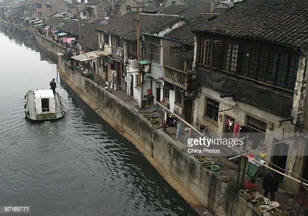 A cleaning boat sails at the Old Canal on February 7 2005 in Wuxi of Jiangsu Province China The canal has a history of 1000 years The pollution...
