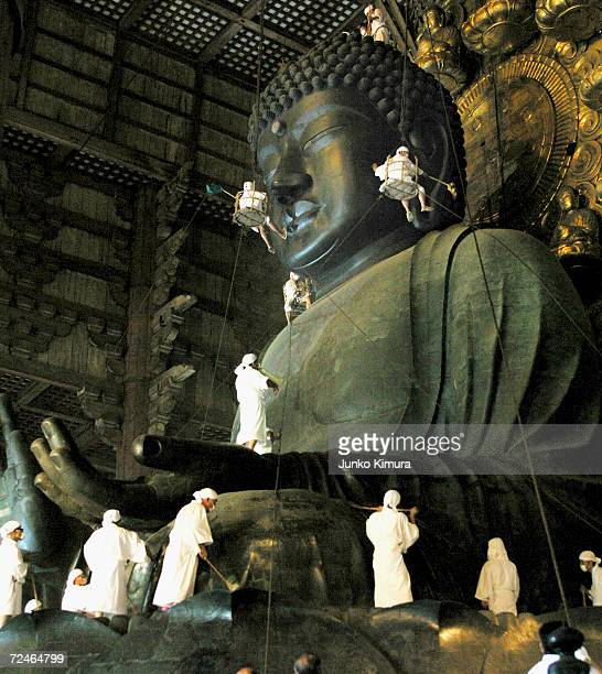 Cleaning gets underway on the 15meterhigh giant statue of Buddha of Todaiji Temple on August 7 2004 in Nara Japan The Buddha which was completed in...
