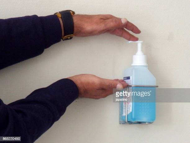 Cleaning hands with disinfectant liquid