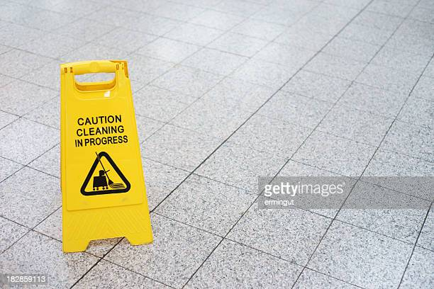 Cleaning in progress sign on the slippery floor