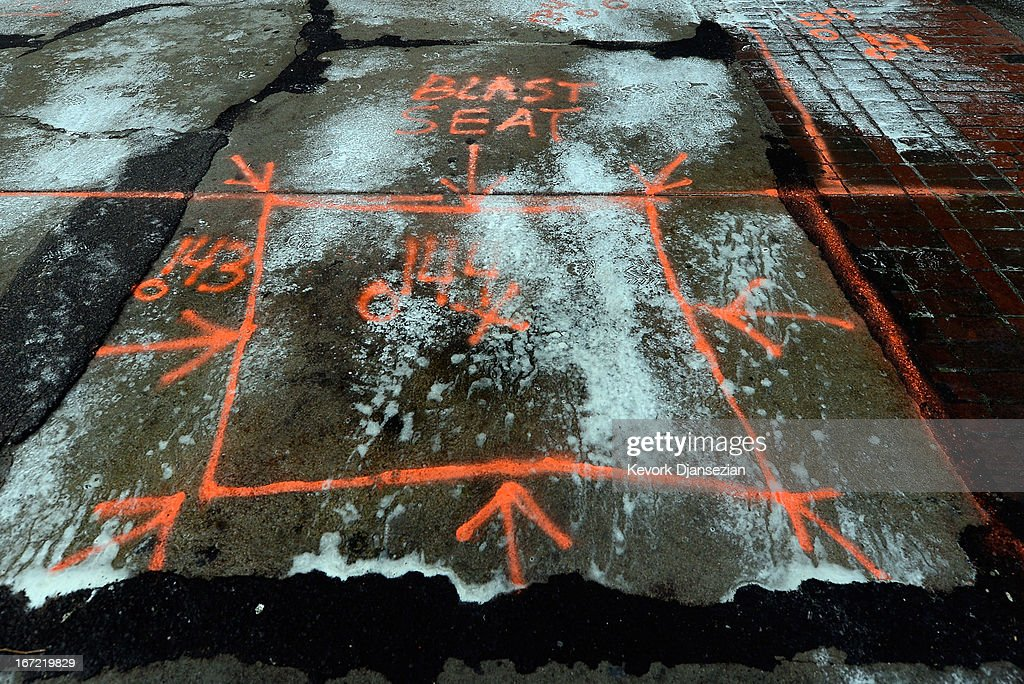 Cleaning material is sprayed on the outlined blast seat on the sidewalk of Boylston Street after the Boston Marathon bombings one week after the FBI handed it back to the city on April 22, 2013 in Boston, Massachusetts. A manhunt ended for Dzhokhar A. Tsarnaev, 19, a suspect in the Boston Marathon bombing after he was apprehended on a boat parked on a residential property in Watertown, Massachusetts. His brother Tamerlan Tsarnaev, 26, the other suspect, was shot and killed after a car chase and shootout with police. The bombing, on April 15 at the finish line of the marathon, killed three people and wounded at least 170.