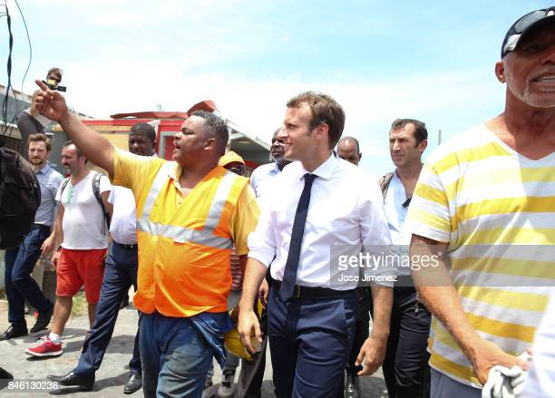 A cleaning official shows the destruction to French Emmanuel Macron during his visit after the passing of Hurricane Irma on September 12 2017 in...