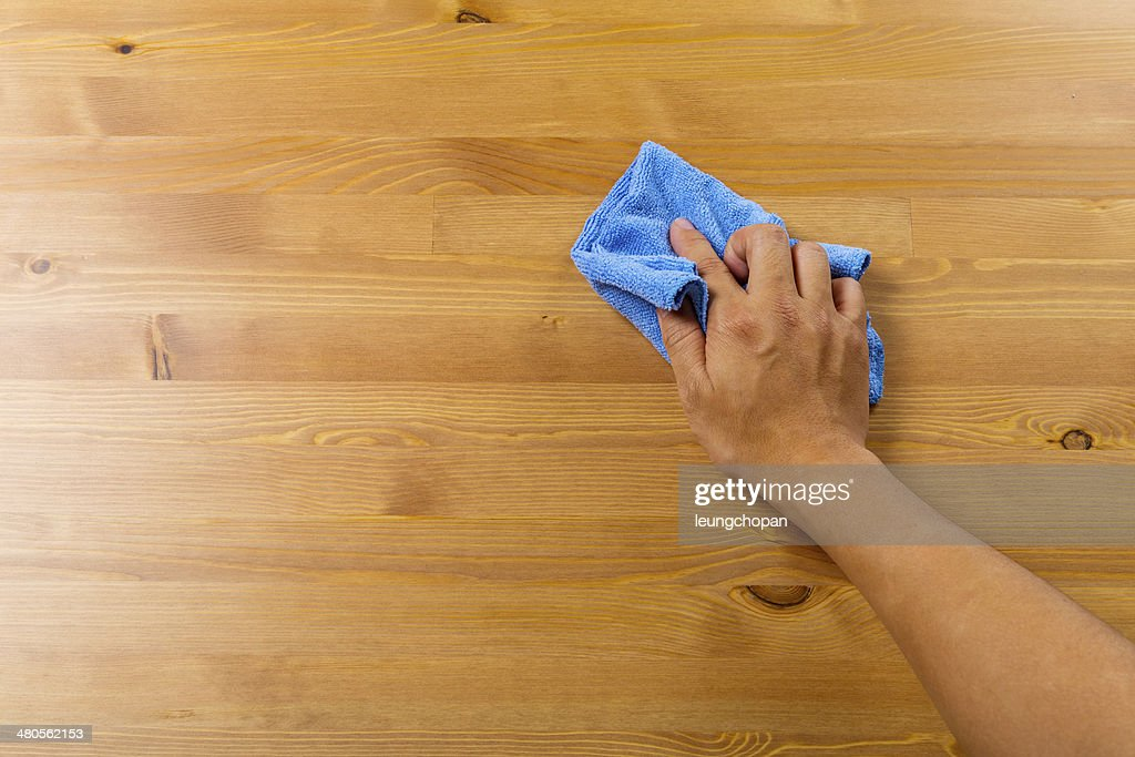 Cleaning table by hand : Stock Photo