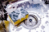 sponge in kitchen sink. Home cleaning concept.