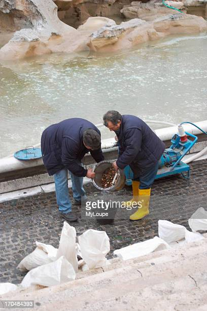 Cleaning Trevi Fountain designed by Pietro da Cortona Bernini and Nicola Salvi is cleaned and emptied of coins three times each week in Rome
