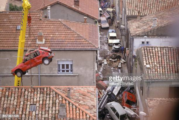 Cleaning up the streets blocked by cars after floods on October 3 1988 in Nimes France
