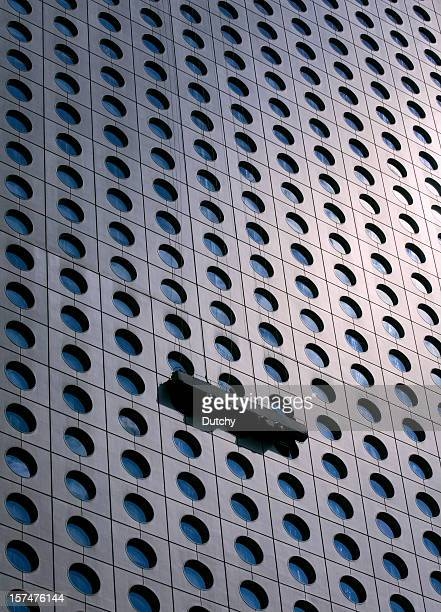Cleaning windows of a Skyscraper in Hong Kong, China.