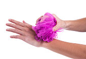 woman's hands use a loofah.
