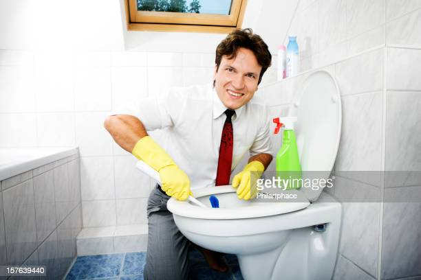 cleaning young business man in bathroom