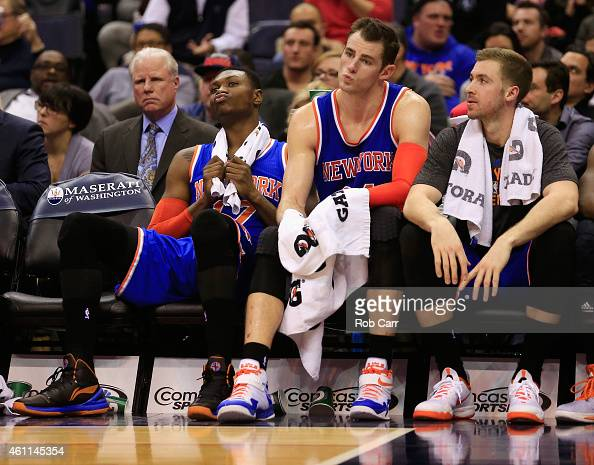 Cleanthony Early Jason Smith and Travis Wear of the New York Knicks sit on the bench during the closing mintues of the Knicks 10191 loss to the...