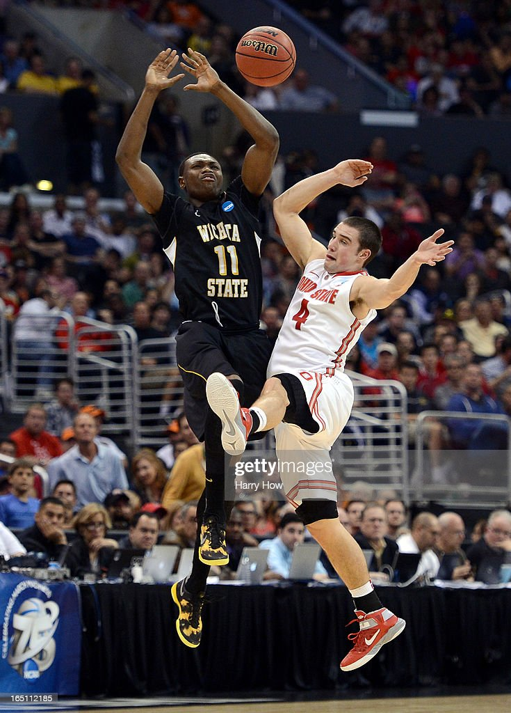 <a gi-track='captionPersonalityLinkClicked' href=/galleries/search?phrase=Cleanthony+Early&family=editorial&specificpeople=10064686 ng-click='$event.stopPropagation()'>Cleanthony Early</a> #11 of the Wichita State Shockers and <a gi-track='captionPersonalityLinkClicked' href=/galleries/search?phrase=Aaron+Craft&family=editorial&specificpeople=7348782 ng-click='$event.stopPropagation()'>Aaron Craft</a> #4 of the Ohio State Buckeyes go after a loose ball in the first half during the West Regional Final of the 2013 NCAA Men's Basketball Tournament at Staples Center on March 30, 2013 in Los Angeles, California.