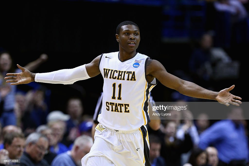 <a gi-track='captionPersonalityLinkClicked' href=/galleries/search?phrase=Cleanthony+Early&family=editorial&specificpeople=10064686 ng-click='$event.stopPropagation()'>Cleanthony Early</a> #11 of the Wichita State Shockers celebrates after a basket in the second half against the Kentucky Wildcats during the third round of the 2014 NCAA Men's Basketball Tournament at Scottrade Center on March 23, 2014 in St Louis, Missouri.