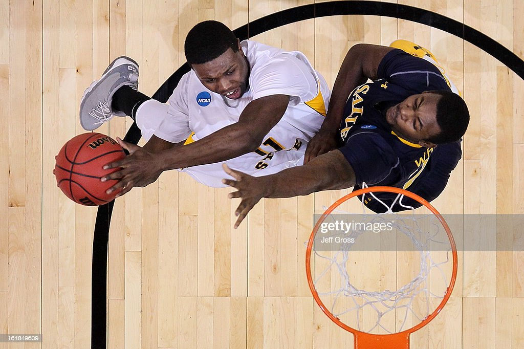 <a gi-track='captionPersonalityLinkClicked' href=/galleries/search?phrase=Cleanthony+Early&family=editorial&specificpeople=10064686 ng-click='$event.stopPropagation()'>Cleanthony Early</a> #11 of the Wichita State Shockers goes up for a shot against <a gi-track='captionPersonalityLinkClicked' href=/galleries/search?phrase=Jerrell+Wright&family=editorial&specificpeople=8980264 ng-click='$event.stopPropagation()'>Jerrell Wright</a> #25 of the La Salle Explorers in the first half during the West Regional of the 2013 NCAA Men's Basketball Tournament at Staples Center on March 28, 2013 in Los Angeles, California.