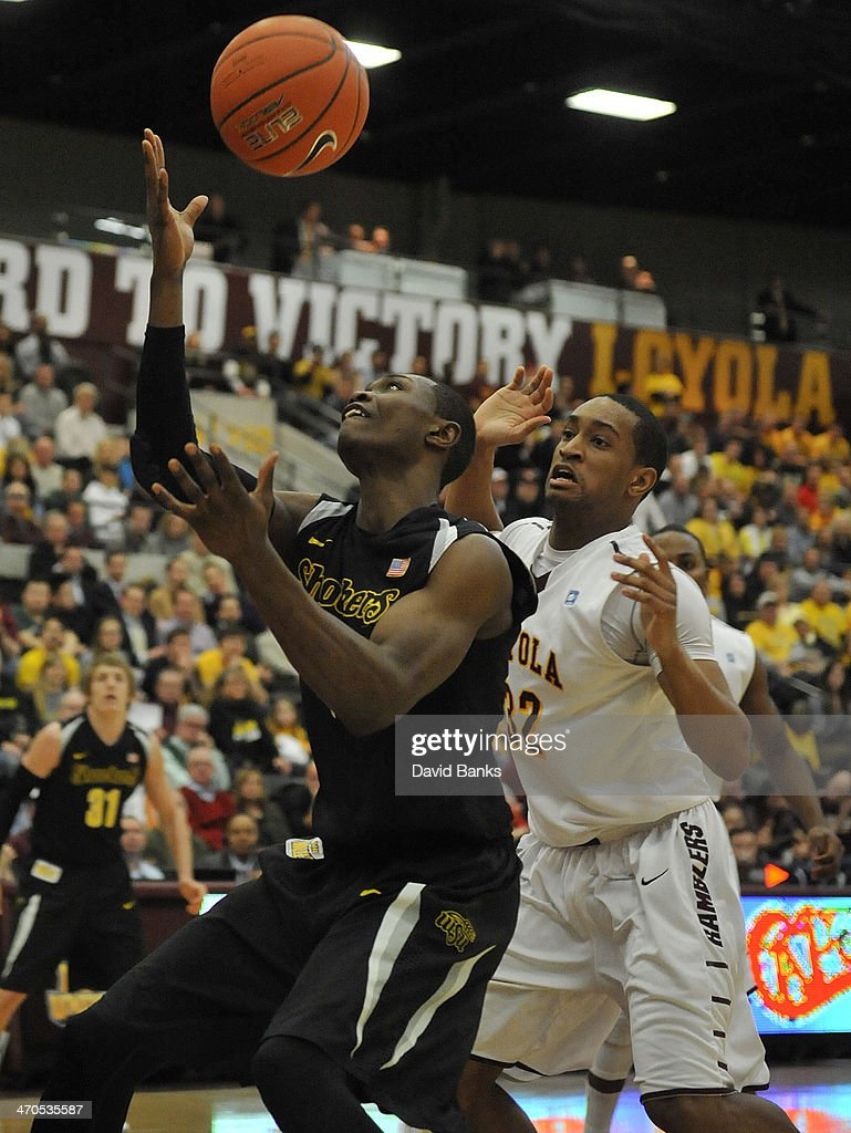 <a gi-track='captionPersonalityLinkClicked' href=/galleries/search?phrase=Cleanthony+Early&family=editorial&specificpeople=10064686 ng-click='$event.stopPropagation()'>Cleanthony Early</a> #11 of the Wichita State Shockers is defended by Christian Thomas #32 of the Loyola-Chicago Ramblers on February 19, 2014 at the Joseph J. Gentile Arena in Chicago, Illinois.