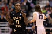 Cleanthony Early of the Wichita State Shockers reacts after making a threepointer in the first half against the Gonzaga Bulldogs during the third...