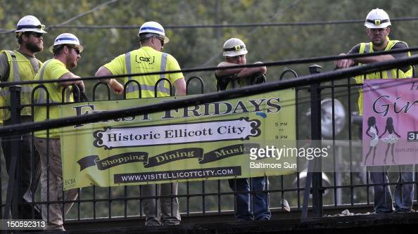 Cleanup continued as workers removed coal cars on Wednesday August 22 following a train derailment that killed two college students early Tuesday in...