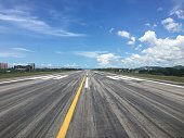 Blank airport runway from pilot view when line up the aircraft on center line before take of with blue sky background and copy space