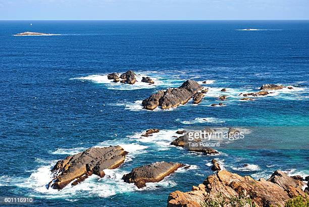 Clear blue sea and the rock formations at Sugarloaf Point, Seals Rocks, New South, Wales, Australia, Oceania