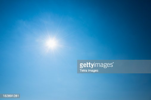 Clear blue sky and solar flare