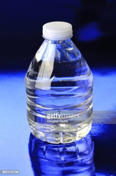 Clear Bottle of Purified Water on a blue background