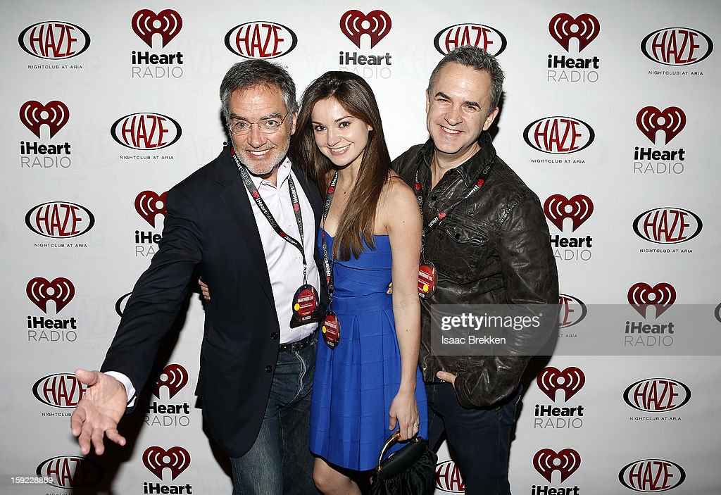 Clear Channel CEO Bob Pittman, (L) Kimberly Beneville and Michael Benneville arrive at the iHeartRadio CES exclusive party featuring a live performance by Ke$ha at Haze Nightclub at the Aria Resort & Casino at CityCenter on January 9, 2013 in Las Vegas, Nevada.