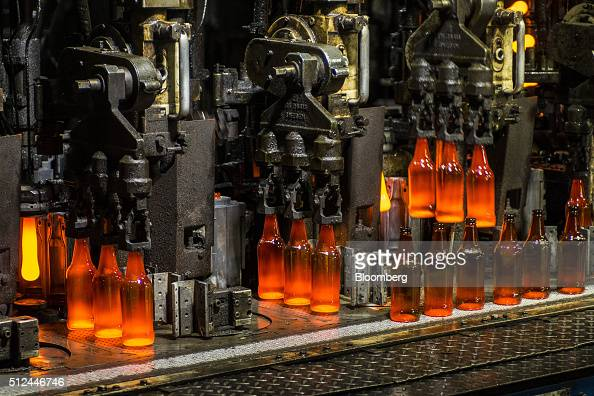 Clear glass bottles glow red with heat during molding at the Nampak Ltd manufacturing plant in Roodekop South Africa on Friday Feb 26 2016 Already...