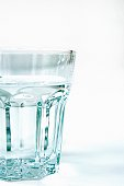 Clear glass tumbler of water.