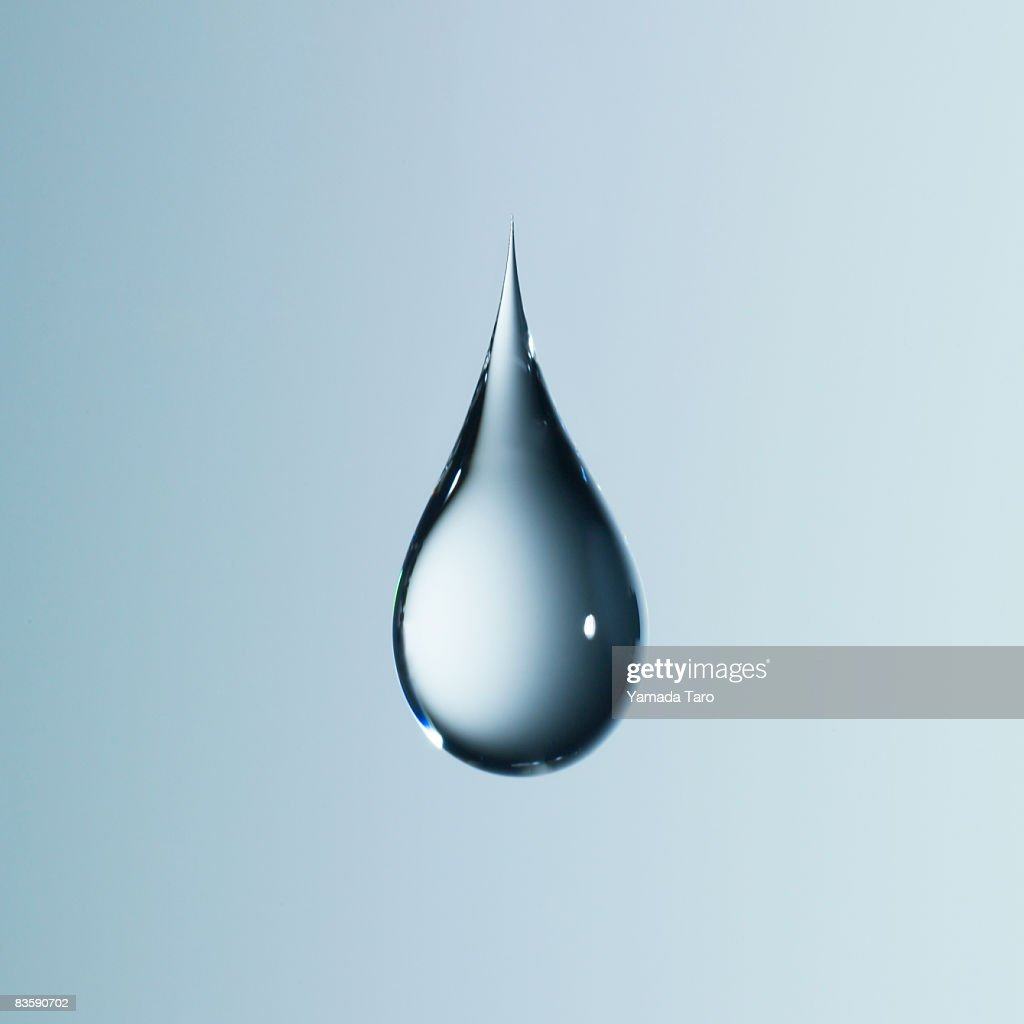 Clear light blue drop on light blue back : Stock Photo