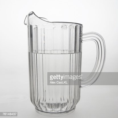 Clear plastic pitcher full of water, side view