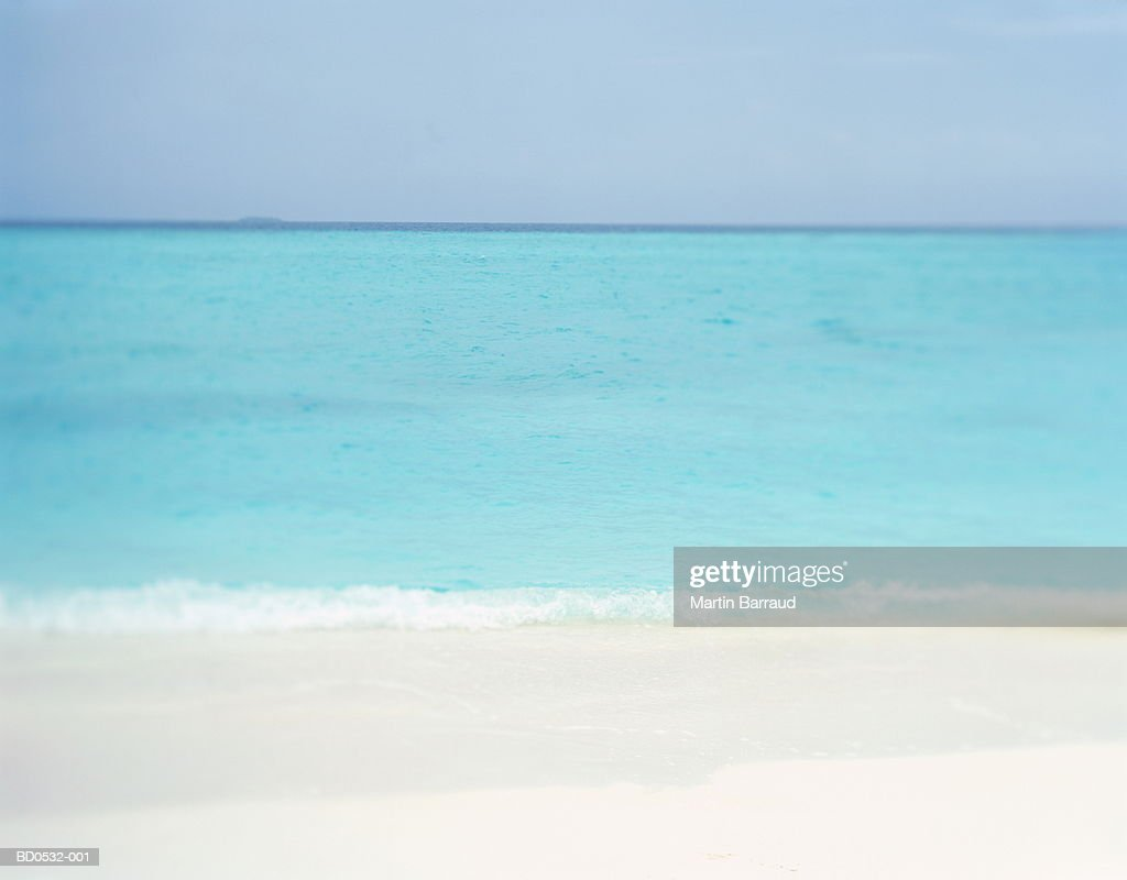 Clear sea lapping deserted tropical beach, Maldives : Stock Photo