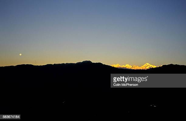 Clear skies at dawn above Kangchenjunga as seen from Gangtok Sikkim northern India Also known as Sewa Lungma it was the third highest mountain in the...